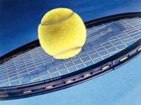 tennis-ball-on-racket.jpg